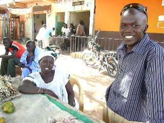 Moussa, IMCEC Loan Officer, with a Kiva Borrower